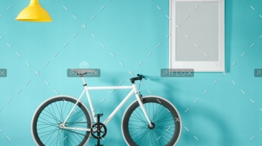 white-bike-in-blue-interior-PMNFYVU